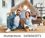 Small photo of concept housing a young family. Mother father and child in new house with a roof at a home