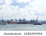 La Spezia, Italy - July 9, 2019: Cranes and containers in the cargo port - stock photo