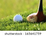 golf ball and driver on green... | Shutterstock . vector #165641759