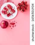 juicy pomegranate with seeds on ... | Shutterstock . vector #1656501934