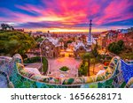 Small photo of Beautiful sunrise in Barcelona seen from Park Guell. Park was built from 1900 to 1914 and was officially opened as a public park in 1926. In 1984, UNESCO declared the park a World Heritage Site