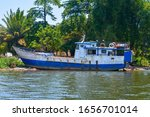Small photo of Old, rusty, dangerous boat left on the shore, occupied by Somali pirates. Dirty coast, metal ship stranded on beach attacked, hijacked by pirates of Somalia. Boat for illegal smuggling of immigrants