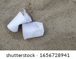Plastic Glasses On Sandy Sea...