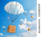 parachute packages flying... | Shutterstock . vector #165680339
