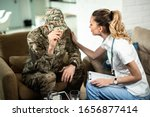 Female Doctor Comforting Sad...
