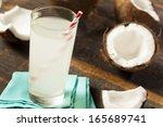 fresh organic coconut water in... | Shutterstock . vector #165689741