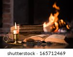 An Open Bible With A Burning...