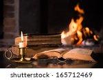 an open bible with a burning... | Shutterstock . vector #165712469