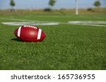 american football on the field... | Shutterstock . vector #165736955