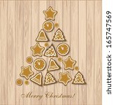 christmas cookies tree on wood... | Shutterstock .eps vector #165747569