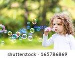 A Little Girl Blowing Soap...