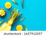Pineapple Juice On Blue Table...