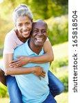 mature man giving woman... | Shutterstock . vector #165818504