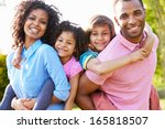 african american parents giving ... | Shutterstock . vector #165818507