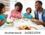 african american family eating... | Shutterstock . vector #165821054