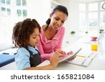 mother and child using digital... | Shutterstock . vector #165821084