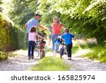 family pushing bikes along... | Shutterstock . vector #165825974