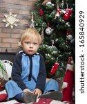 cute little boy and christmas... | Shutterstock . vector #165840929