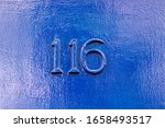House Number 116 On A Blue...