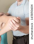 chiropractor adjusting young... | Shutterstock . vector #165850604