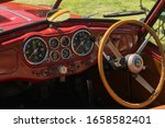 Llangollen Wales UK - July 1 2017: Instrument panel and steering wheel of a Jowett Jupiter typical of British sports cars of the 1950s - stock photo