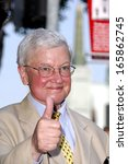 roger ebert at the induction... | Shutterstock . vector #165862745
