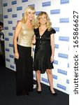 Small photo of Kathleen Walas, Lee Ann Womack at Avon Foundation 50th Anniversary Celebration, American Museum of Natural History, New York, NY, October 25, 2005