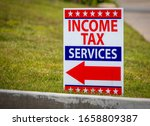 Sign reading income tax sevices ...