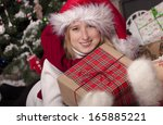 happy girl with presents near... | Shutterstock . vector #165885221