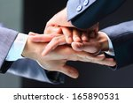 close up of business partners... | Shutterstock . vector #165890531