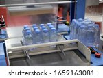 Small photo of Shrink film wrapping machine for bottle of water