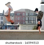 "Small photo of Two athletic young Britons engage in their passion for ""parkour"" or ""free running"" on the seafront at Great Yarmouth"