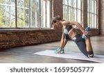 Sporty young woman hatha yoga...