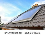 solar panels on the house ... | Shutterstock . vector #165964631