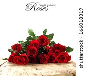 Stock photo few roses and wooden desk 166018319