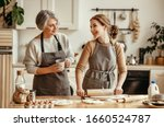 Small photo of happy family grandmother old mother mother-in-law and daughter-in-law daughter cook in kitchen, knead dough and bake cookies