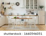 Small photo of Interior design or bright white modern kitchen, fresh vegetables fruit wooden table, empty renovated furnished studio or flat apartment for rent, mortgage, real estate, renovation service concept