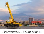 A Yellow Wheeled Truck Crane...