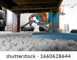 Man Vacuuming Under Coffee...