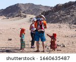Small photo of Hurghada, Egypt - 12.12.2019. Bedouin children entertain tourists. Kids of the Sahara desert. Children-natives extort gifts from tourists.