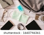 Small photo of Top view or flat lay of face mask ,sanitizer hand gel to protect against Coronavirus or COVID-19 and neccessary items for daily life and working , Today's personal item for health protection concept