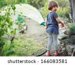 little happy girl watering... | Shutterstock . vector #166083581