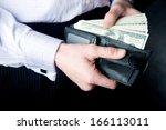 dollars in the men's wallet | Shutterstock . vector #166113011