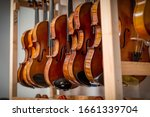 Racks Of Violins Hanging In A...