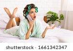 Glamorous Housewife Chatting O...