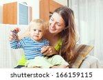 portrait of happy long haired... | Shutterstock . vector #166159115