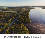 View of Kem River, Kemijoki, in a Liedakkala village in the municipality of Keminmaa in Lapland in north-western Finland, Aerial summer dawn sunrise