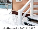 Snow Covered Porch Railing....