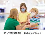 family with kids in face mask...   Shutterstock . vector #1661924137