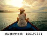 Woman Traveling By Boat At...